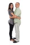 Jong aantrekkelijk paar dat op wit wordt geïsoleerd Stock Fotografie