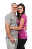 Jong aantrekkelijk paar dat op wit wordt geïsoleerdo Stock Foto
