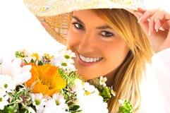 Jong blond meisje met bloemen Stock Afbeelding