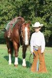 Jong cowboy en paard royalty-vrije stock foto's