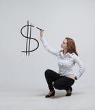 Jong de dollarsymbool van de vrouwentekening Royalty-vrije Stock Foto