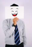 Jong die de lachmasker van ZakenmanWearing op wit wordt geïsoleerd Royalty-vrije Stock Afbeeldingen