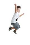 Jong geitje dat met een t-shirt met een geschilderde gitaar springt Royalty-vrije Stock Afbeeldingen
