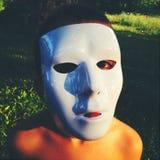 Jong geitje die masker dragen royalty-vrije stock foto's