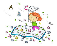 Jong geitje en boek Stock Afbeelding