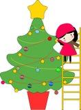 Jong geitje en Kerstmisboom Stock Foto's