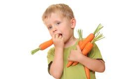 Jong geitje en wortel Stock Afbeeldingen