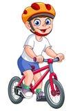Jong geitje op fiets Stock Foto