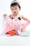 Jong geitje in roze kleding royalty-vrije stock foto's