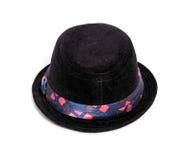 Jong geitje zwarte hoed Stock Fotografie