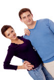 Jong gelukkig paar die in geïsoleerde liefde glimlachen Royalty-vrije Stock Fotografie