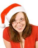 Jong glimlachend meisje met santahoed Stock Fotografie