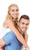 Jong glimlachend paar in geïsoleerd liefdeportret Royalty-vrije Stock Afbeeldingen