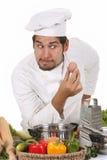 Jong grappig chef-kok en ei Stock Fotografie