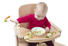 Jong kind dat als hoge voorzitter eet Stock Foto's