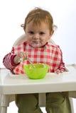 Jong kind het eten Stock Foto's