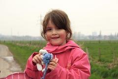 Jong kind met stuk speelgoed Stock Foto's