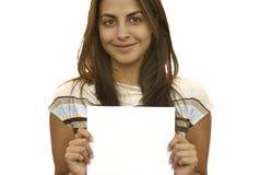 Jong meisje dat een teken 1 houdt Stock Fotografie