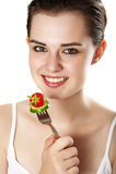 Jong meisje dat groenten eet Royalty-vrije Stock Fotografie