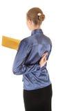 Jong meisje in de bureaukleren en met een geel Royalty-vrije Stock Foto