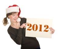 Jong meisje in de hoed van de Kerstman Stock Foto's