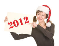 Jong meisje in de hoed van de Kerstman Stock Foto