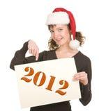 Jong meisje in de hoed van de Kerstman Royalty-vrije Stock Afbeeldingen