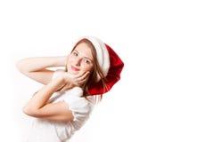 Jong meisje in de hoed van de Kerstman Stock Fotografie