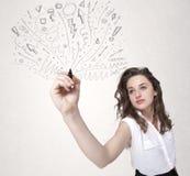 Jong meisje die en abstracte lijnen trekken skteching Stock Fotografie