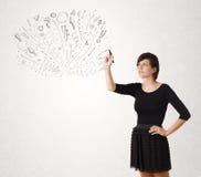 Jong meisje die en abstracte lijnen trekken skteching Royalty-vrije Stock Foto's