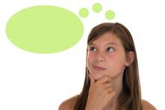 Jong meisje die met toespraakbel denken en copyspace Royalty-vrije Stock Fotografie