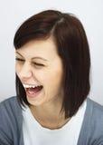 Jong meisje die oprecht lachen royalty-vrije stock foto's