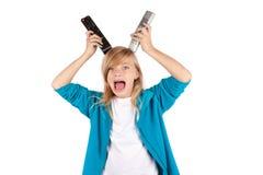 Jong meisje die pret met afstandsbedieningen maken Stock Fotografie