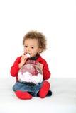 Jong meisje die suikergoed eten royalty-vrije stock afbeelding