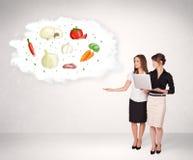 Jong meisje die voedingswolk met groenten voorstellen Royalty-vrije Stock Afbeelding