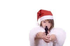 Jong meisje in het kanon van de de hoedenholding van de Kerstman Royalty-vrije Stock Foto's