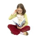 Jong meisje met boek Stock Fotografie