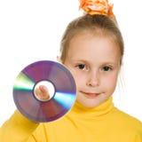 Jong meisje met een compact disc Stock Foto