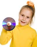 Jong meisje met een compact disc Stock Afbeeldingen