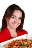 Jong meisje met een pizza stock fotografie