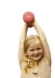 Jong meisje met gewichten Stock Afbeeldingen