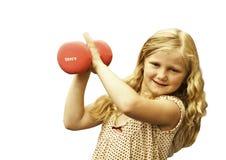 Jong meisje met gewichten Royalty-vrije Stock Foto's