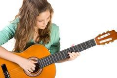 Jong meisje met gitaar. stock afbeeldingen