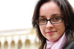 Jong meisje met glazen en sjaal Stock Foto's