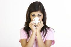 Jong meisje met het runnen van neus Royalty-vrije Stock Foto