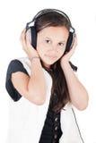 Jong meisje met hoofdtelefoons Stock Foto