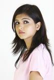 Jong meisje in moderne kleding stock foto's