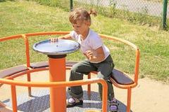 Jong meisje op de carrousel Royalty-vrije Stock Foto's