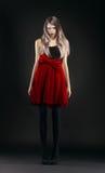 Jong meisje in rode rok royalty-vrije stock afbeelding