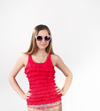 Jong meisje in roze de zomerkleren royalty-vrije stock foto